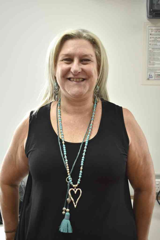 IMPACT Community Services' Choirmaster Jo Carr